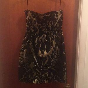 Strapless black and metallic gold dress